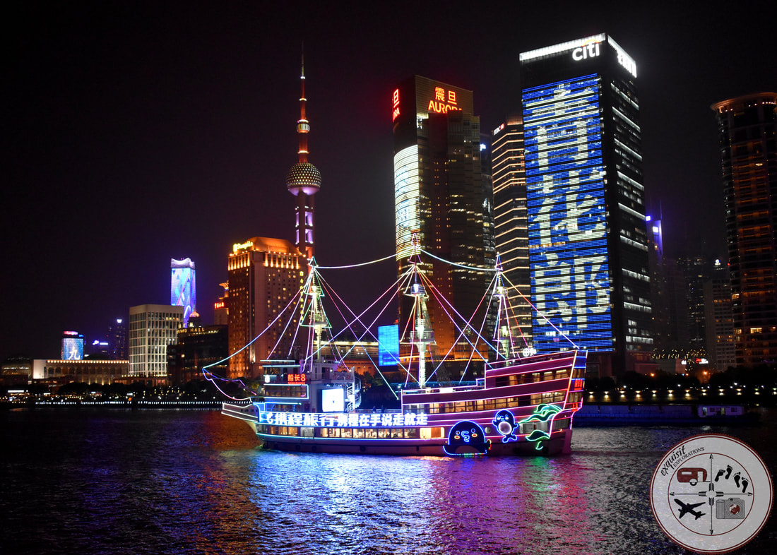 Neon-Lit Boats Dot the Huangpu River Scene; Shanghai, China; New Shanghai; Photos to Inspire your Wanderlust