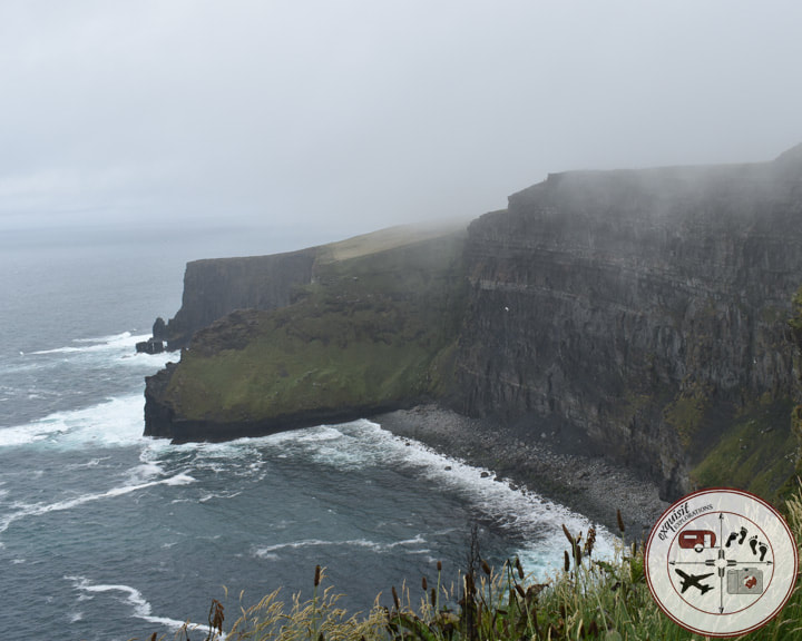 Fog nearly lifted over the Cliffs of Moher in Ireland; must-see places in Ireland