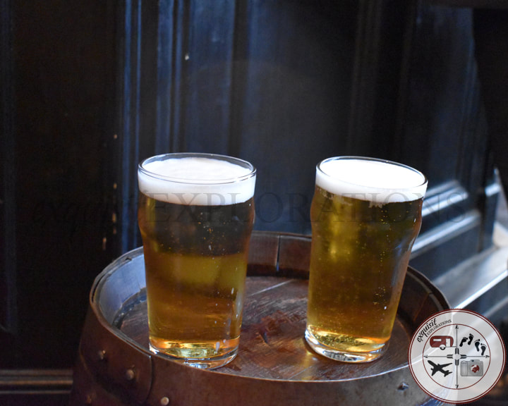 Grab a pint with a friend at East India Arms, London, England, UK; travel tips, budget travel